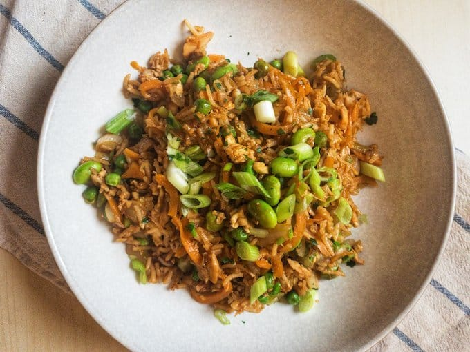 Salmon Fried Rice - A delicious healthy dinner recipe packed with veggies, salmon and egg. Better than a takeaway and the perfect way to use up leftover rice and frozen vegetables.