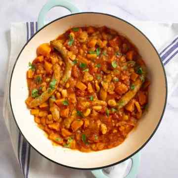 A simple but comforting sausage casserole with cannellini beans, carrots and a rich tomato sauce. Perfect winter warmer.