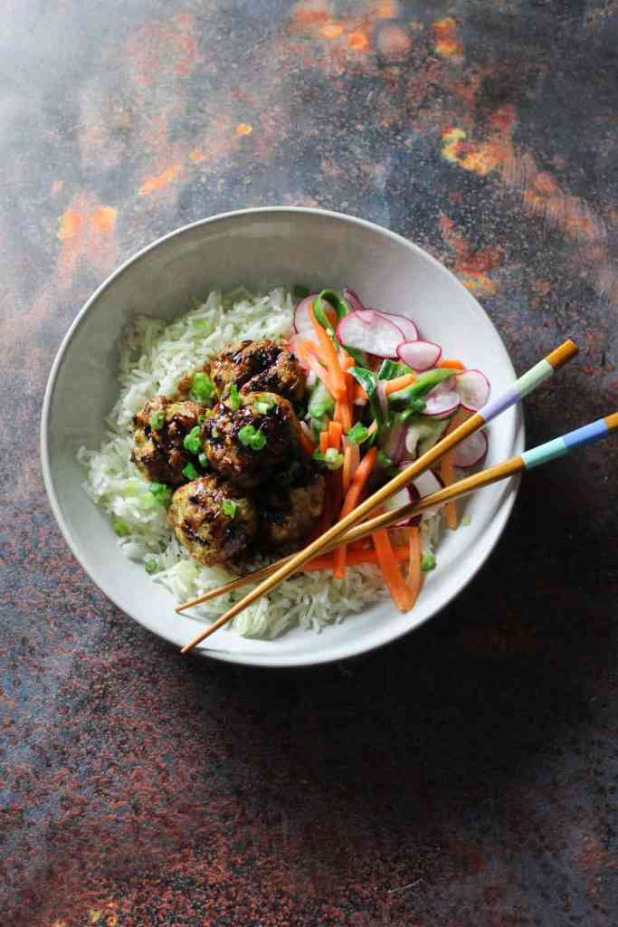 Delicious pork meatballs with a sticky soy, ginger and sweet chilli glaze, paired perfectly with a crunchy and tangy pickled slaw.