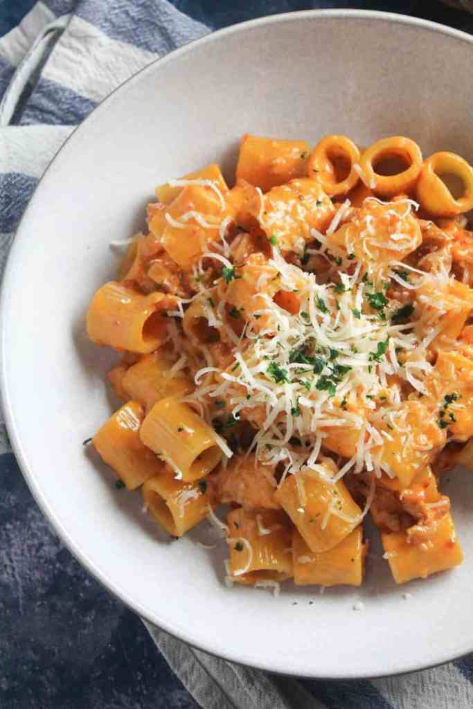 close up of Rigatoni pasta with a creamy sausage and tomato sauce,