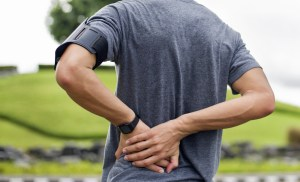 man running and exercising through lower back pain