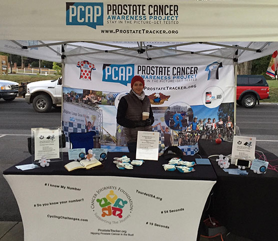 A picture of a volunteer in the prostate cancer awareness booth at the Alpine Loop Gran Fondo bicycle ride in Harrisonburg, Virginia.