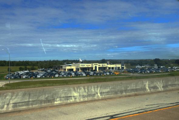 Chrysler_Dodge_Jeep_RAM-dealership-USA-street_scene-2015