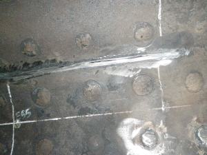 The old weld has been almost fully ground out. Note the gap starting to form between the sheets.