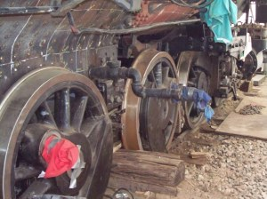 The blocking sticking out from the wheels is currently supporting the weight of the locomotive.