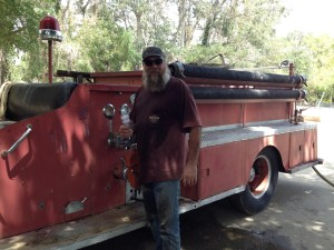 Dave Mull with Independence's first fire truck.