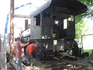 Dave and Bob guide the locomotive out
