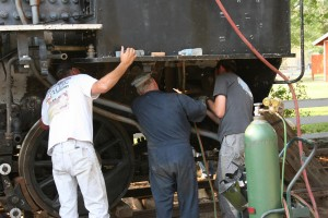 Marty, Travis and Forest finish adjusting and running all the piping under the cab.