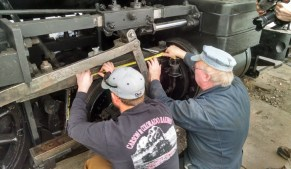 Charlie and Marty measuring and making strike points for piston stoke.