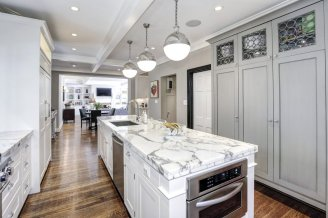 the-kitchen-is-bright-and-updated-with-marble-countertops-and-luxury-appliances