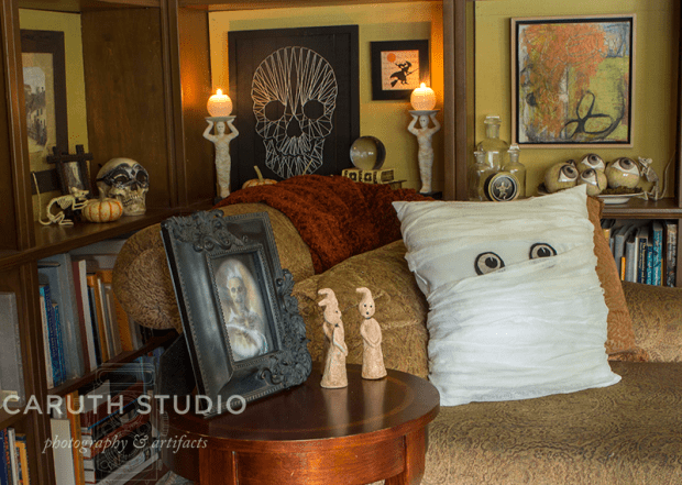 Mummy pillow on chaise in the corner of the halloween theme decorated library
