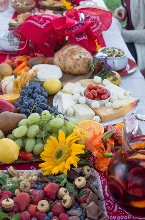 Chili_party spread with fruit, cheese, flowers and nuts