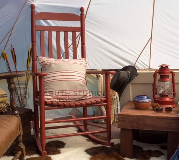 rocking chair on cowhide rug