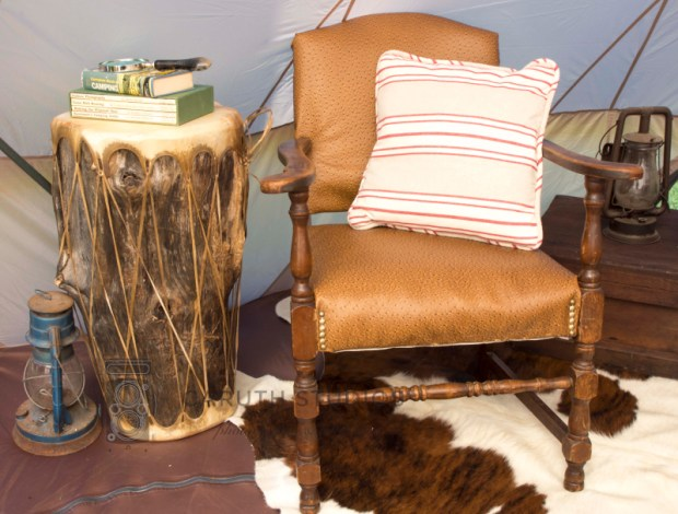 leather armed chair with hide drum side table
