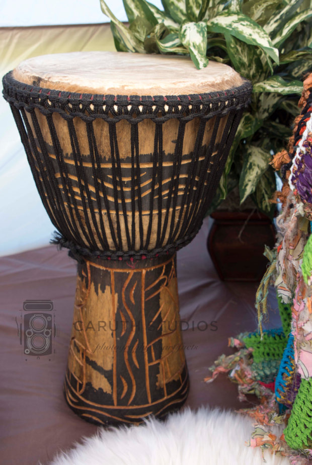 african carved wood and hide drum