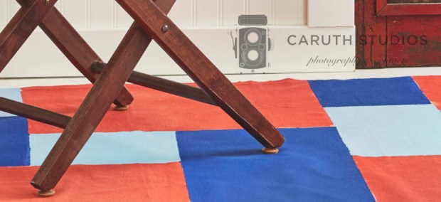 Drop cloth rug under chair