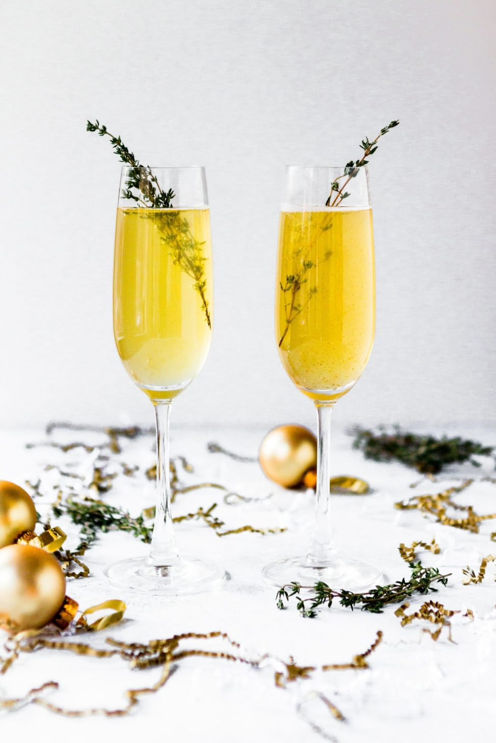 two champagne laasses on a decorated holiday table