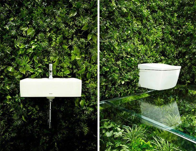 A parede deste banheiro, ao invés de revestimento frio (cerâmica, mármore, porcelanato) . recebeu um lindo jardim vertical