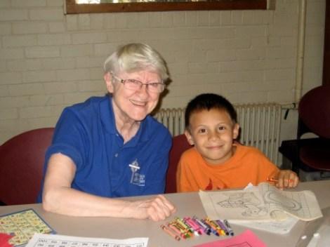 Vivian and a 1st grader work on reading skills