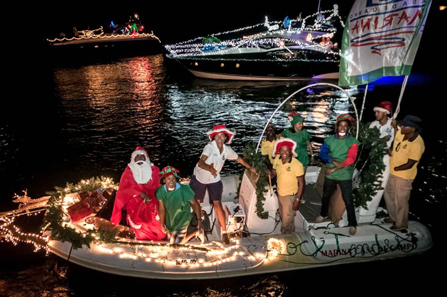 Santas, turtles, dolphins & reindeer at the Christmas boat parade in the Marina Casa de Campo