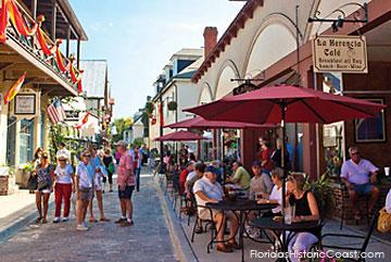 Al fresco dining along narrow historic Aviles Street