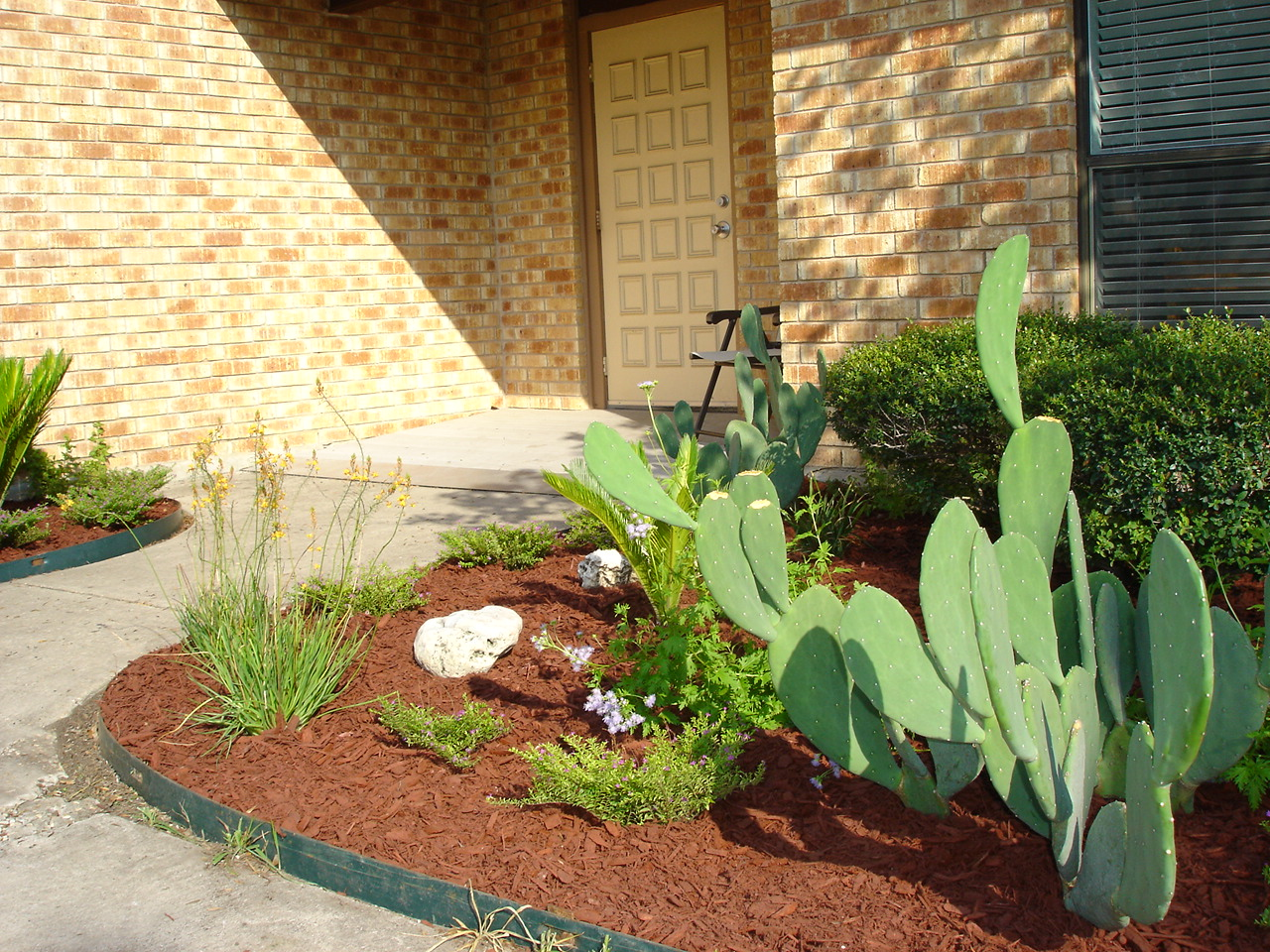 Bro. Brian mulched the front flower beds this weekend and now we have a new look!