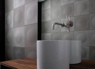 Baño con mosaicos de hormigón
