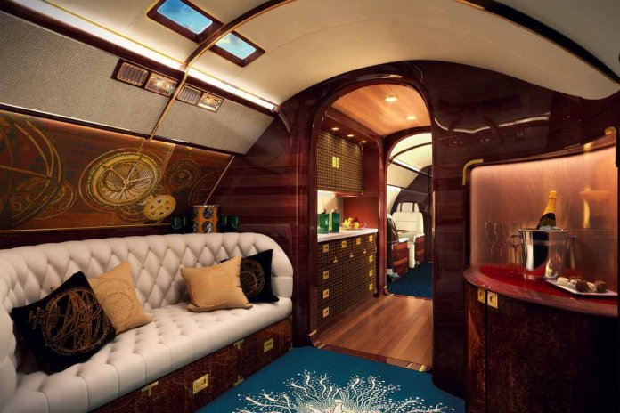 when-you-enter-the-plane-youre-faced-with-a-grand-entryway-lined-with-planked-and-pegged-wood-similar-to-what-youd-find-on-a-yacht-the-entire-interior-was-inspired-by-a-custom-yacht-built-in-1939