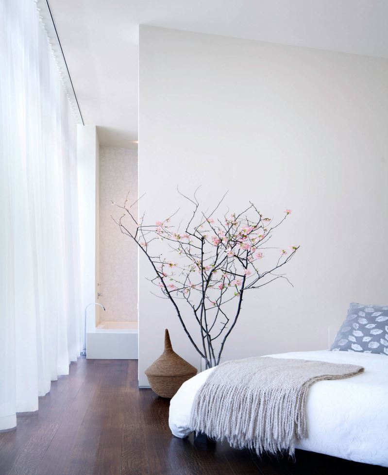 Cherry-blossom-branches-in-a-modern-bedroom