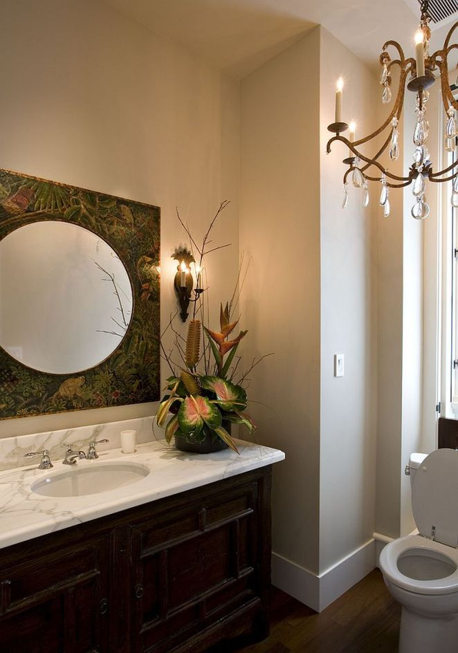 Fabulous-mirror-adds-to-the-tropical-theme-of-the-powder-room