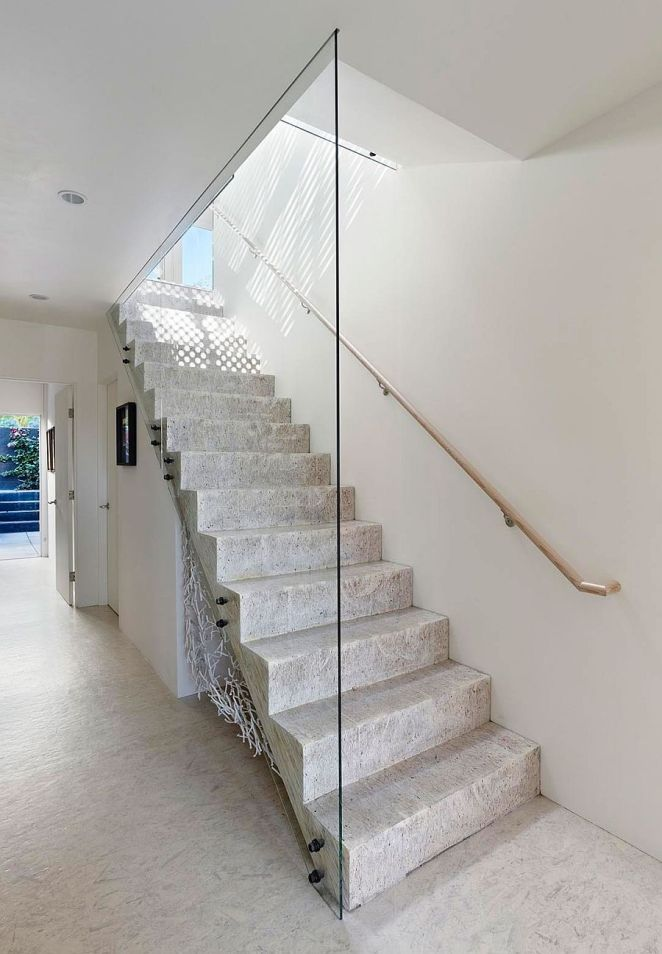 Minimal-modern-staircase-connects-teh-various-levels-of-revamped-San-Francisco-home