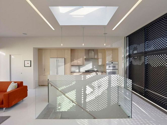 Skylight-above-the-staircase-brings-natural-light-to-even-the-lower-levels-of-the-house