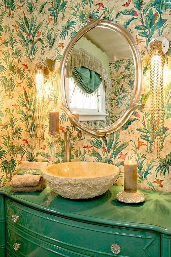 Tropical-powder-room-with-turquoise-vanity-glittering-lighting-and-bold-wallpaper