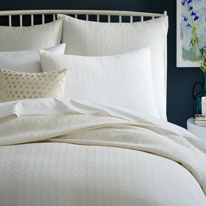 White-bedding-is-a-refreshing-choice-with-dark-walls