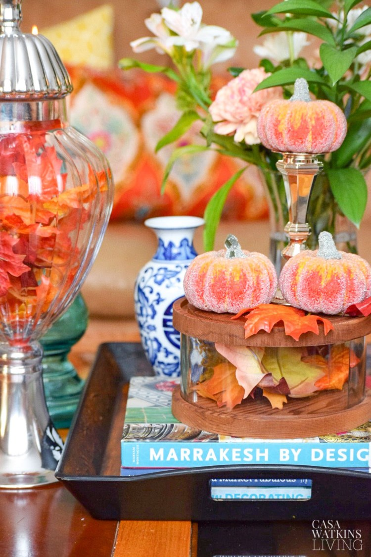 decorating with pumpkins on a coffee table