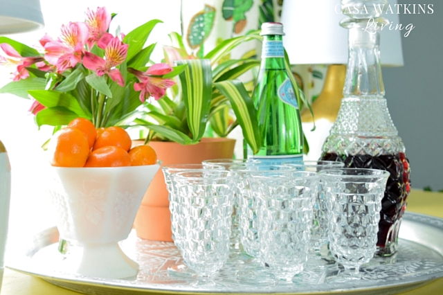 Use Moroccan trays on a buffet table with cocktail glasses and decanter