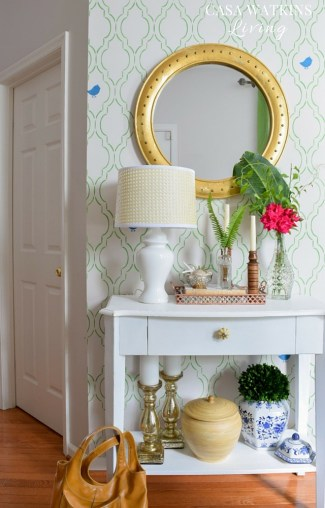Green stenciled wall shines in this tropical entryway