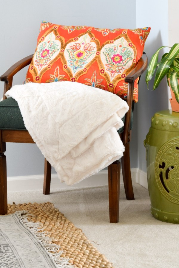 Colorful Indian pillow in a global-style dining room