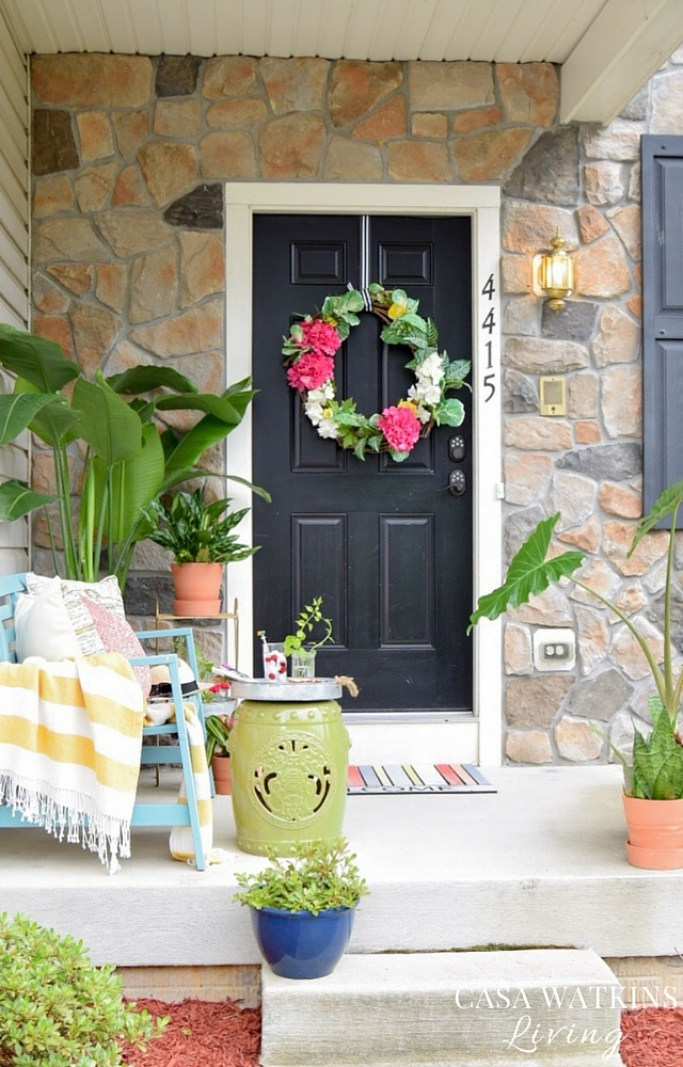 global eclectic porch with tropical styling