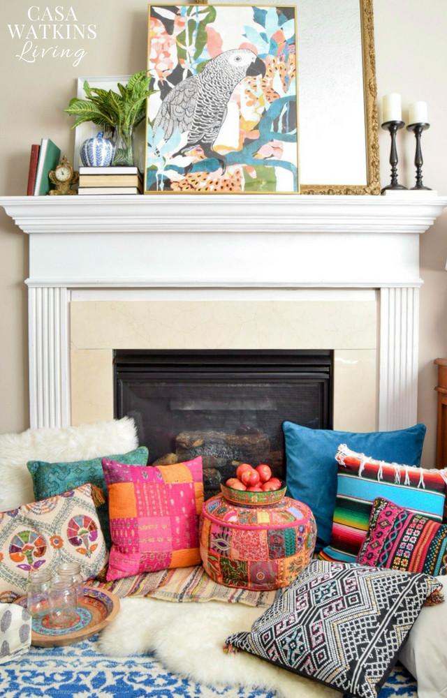 Gather global boho pillows around fireplace