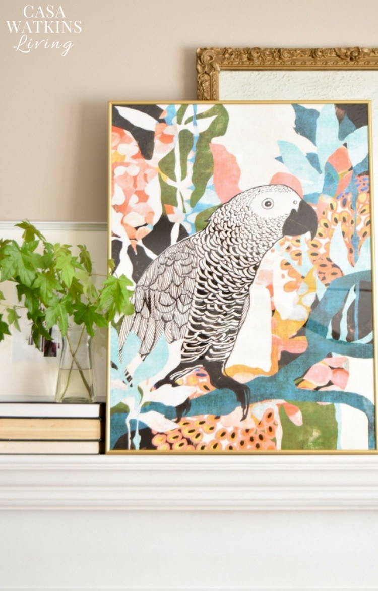 Simple fall mantel decor with maple leaves and tropical parrot art