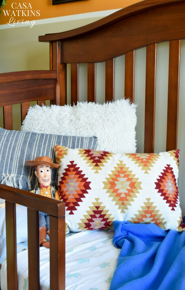 Love these aztec inspired pillows and boho like fringe pillow to add pops of color