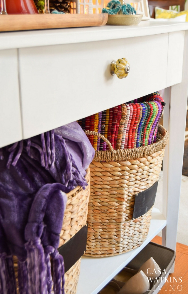 Use basket at entryway for blanket and extra rug during winter months