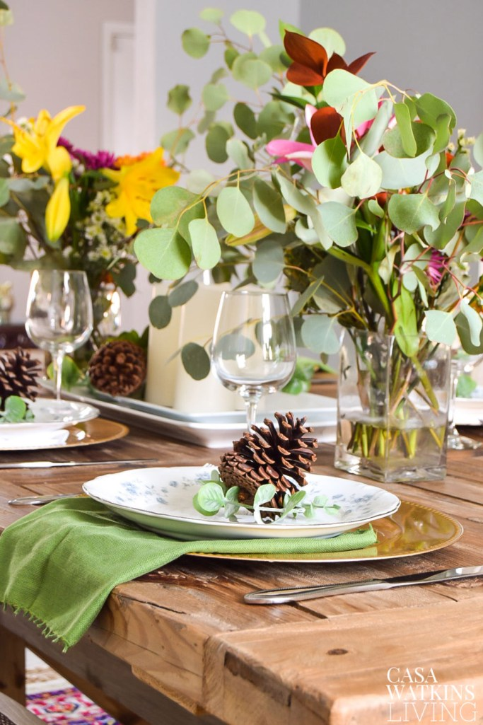 winter tablesetting idea with pinecones and eucalyptus centerpiece