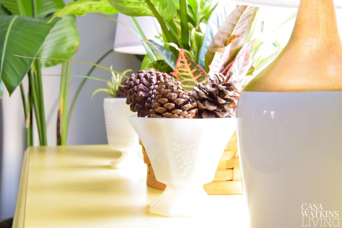 use pinecones in milk glass containers for winter decor