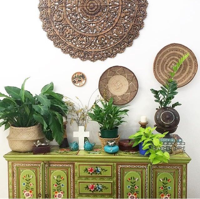 Green indian painted chest with basket wall decor of La Boheme House