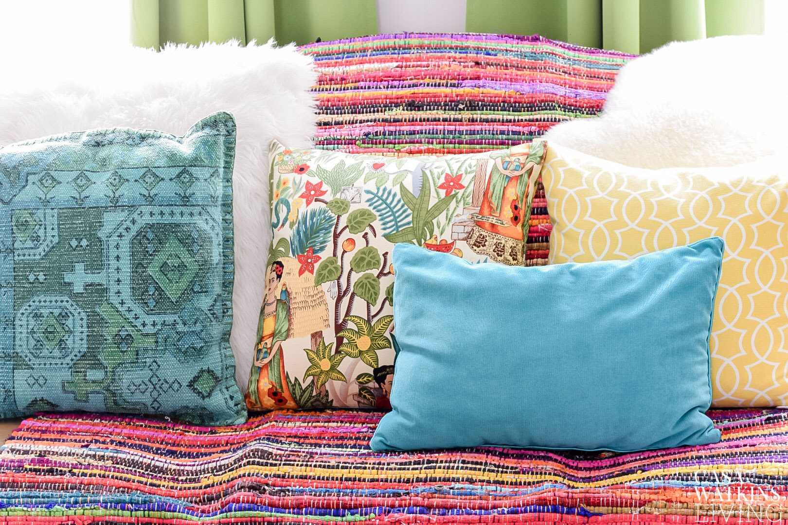boho style rag rug used as couch cover with pillows