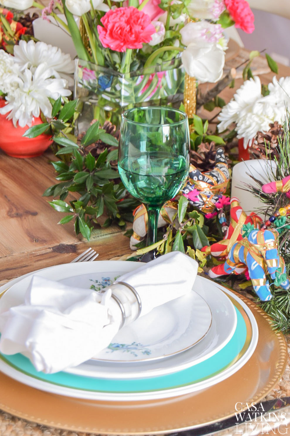 Layer plastic plates with your ceramic plates to add pops of color without spending much on holiday table decor