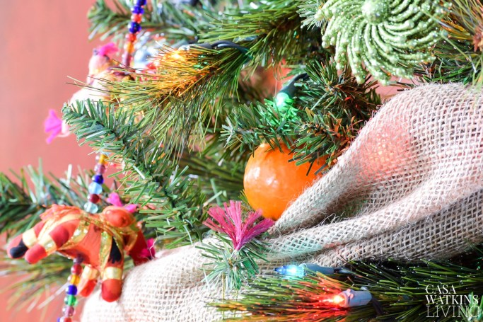 faux tangerines and palm leaves for christmas tree decor