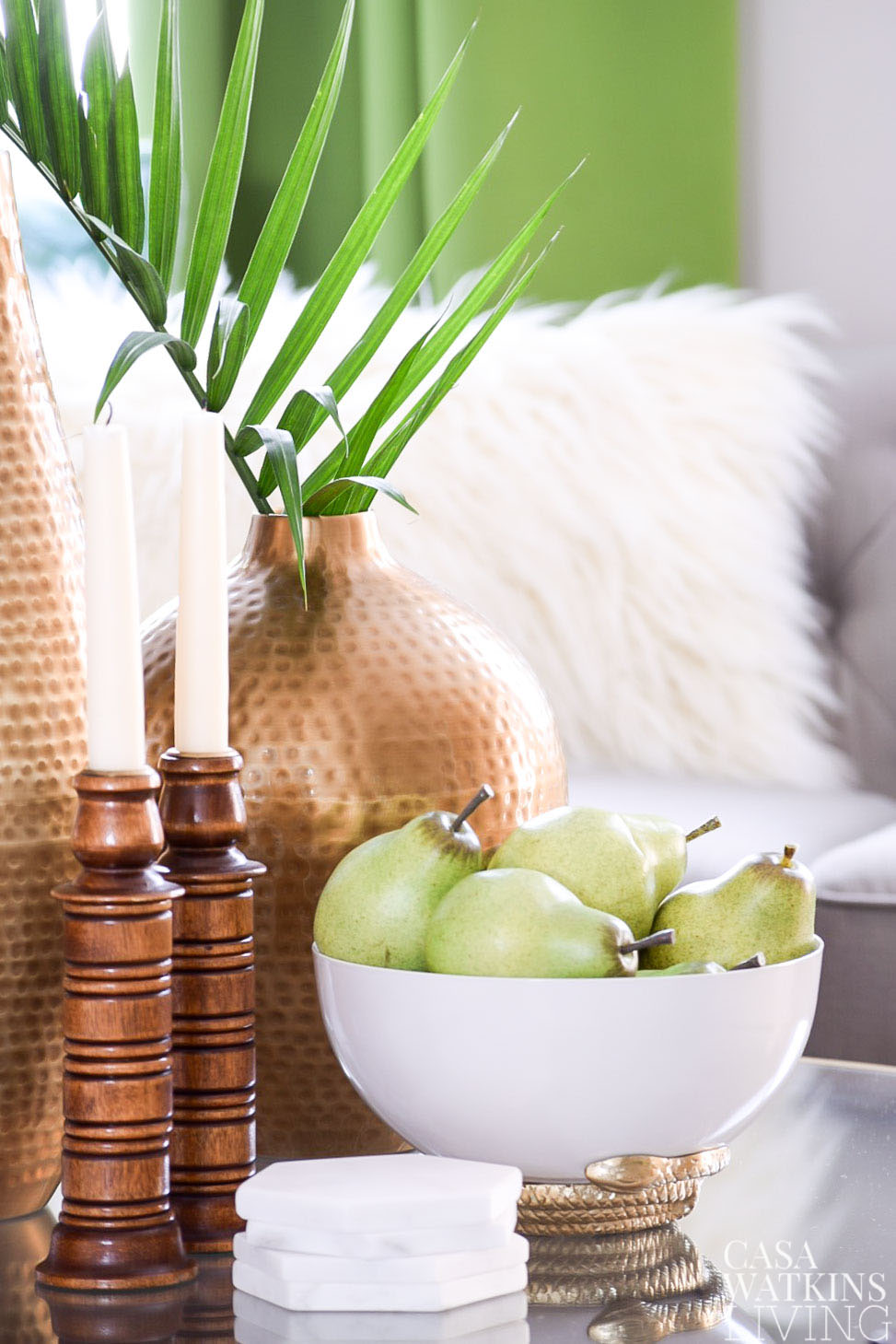 global eclectic table styling with green pears and palm frond